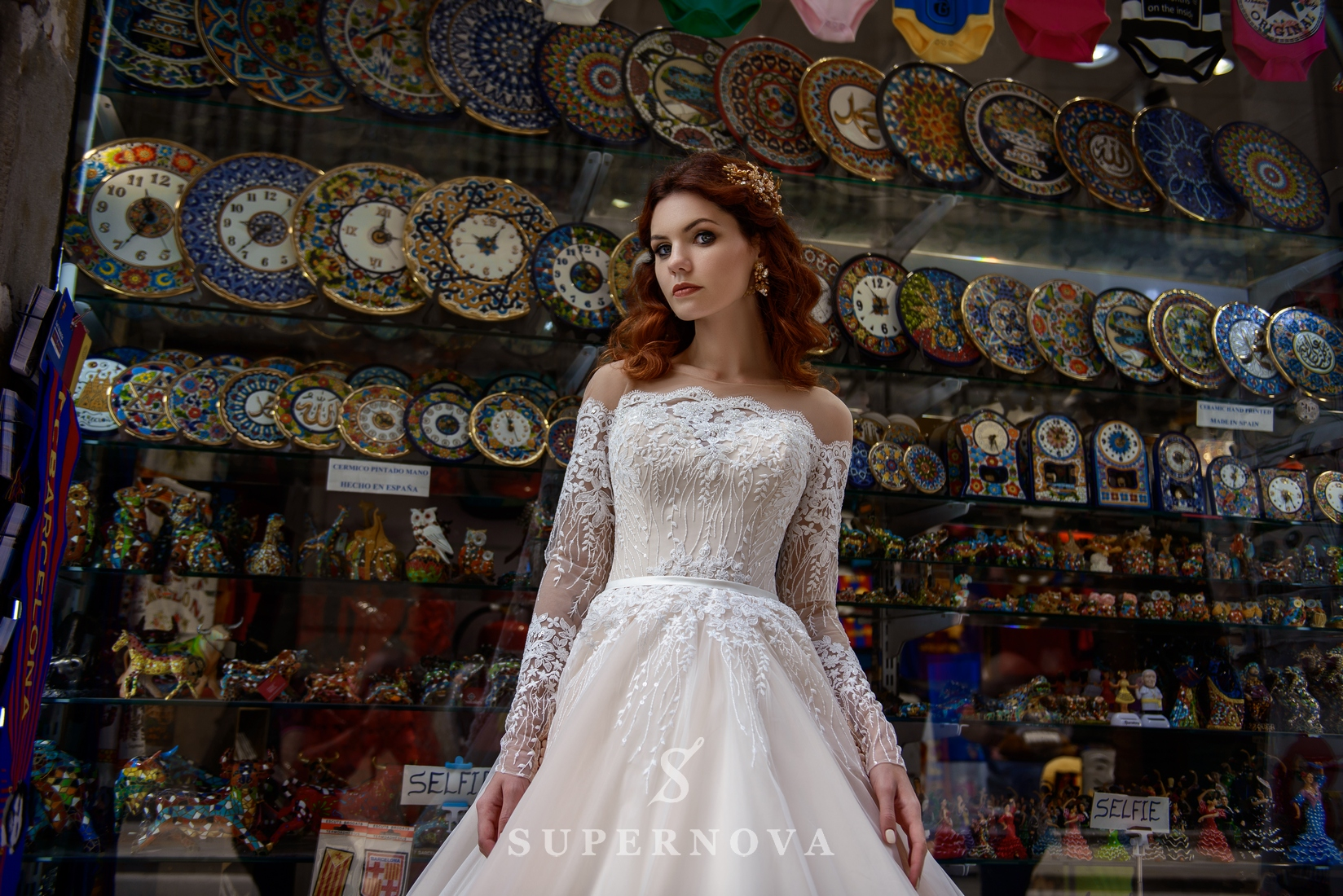 Wedding dress with long sleeves and open shoulders from SuperNova-1