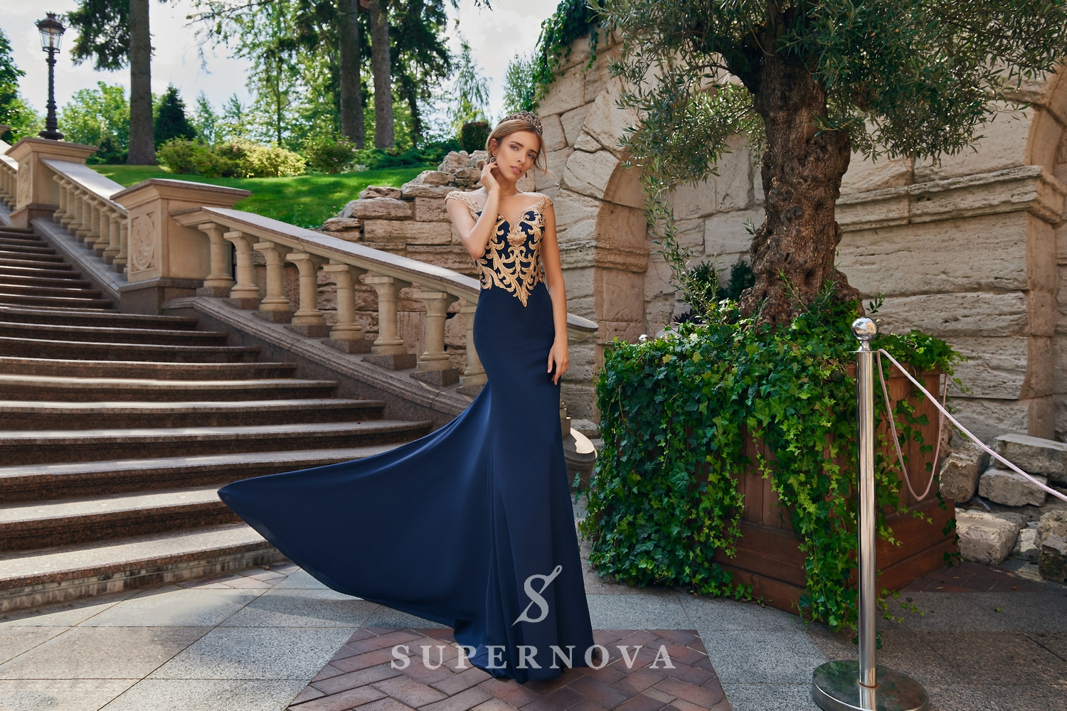 Evening dress of the godet silhouette with appliqués on the corset wholesale from Super Nova.-1