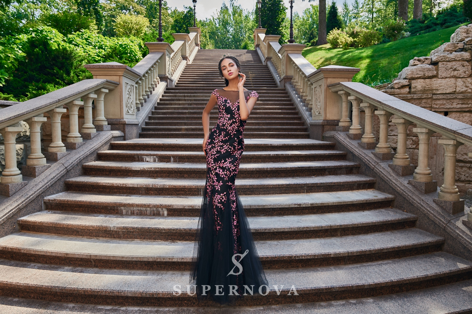 A close-fitting guipure evening dress on wholesale from Super Nova-1