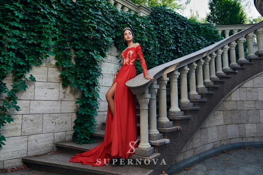 A straight long-sleeved evening dress with the descending skirt from Super Nova. VN-026