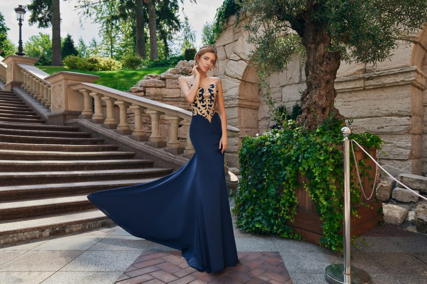 Evening dress of the godet silhouette with appliqués on the corset wholesale from Super Nova.-5
