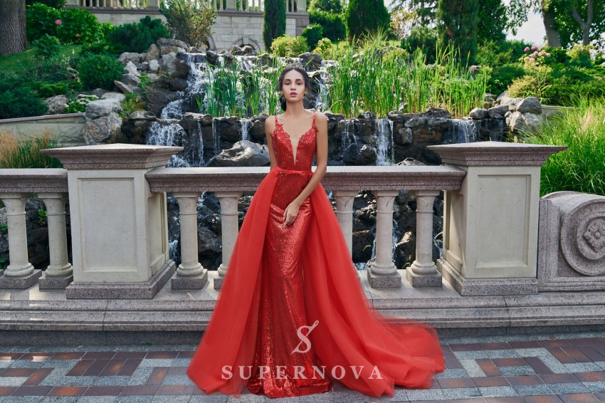The sparkly evening dress of godet silhouette from Super Nova-6