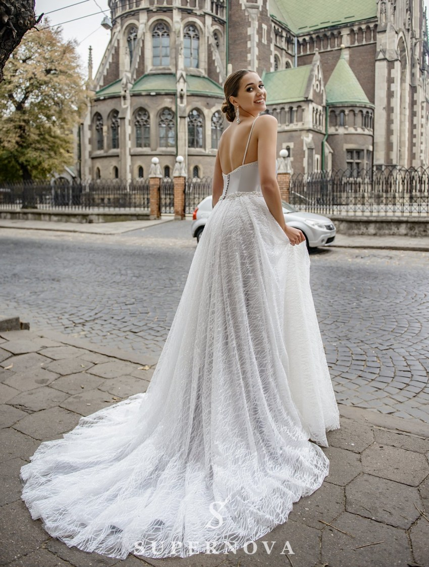 Wedding dress with drapery on the corset on wholesale from SuperNova-3