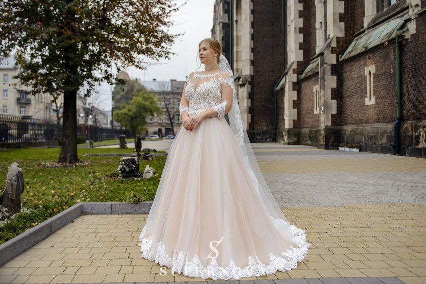 Plus size wedding dress with a translucent corset on wholesale from SuperNova-1