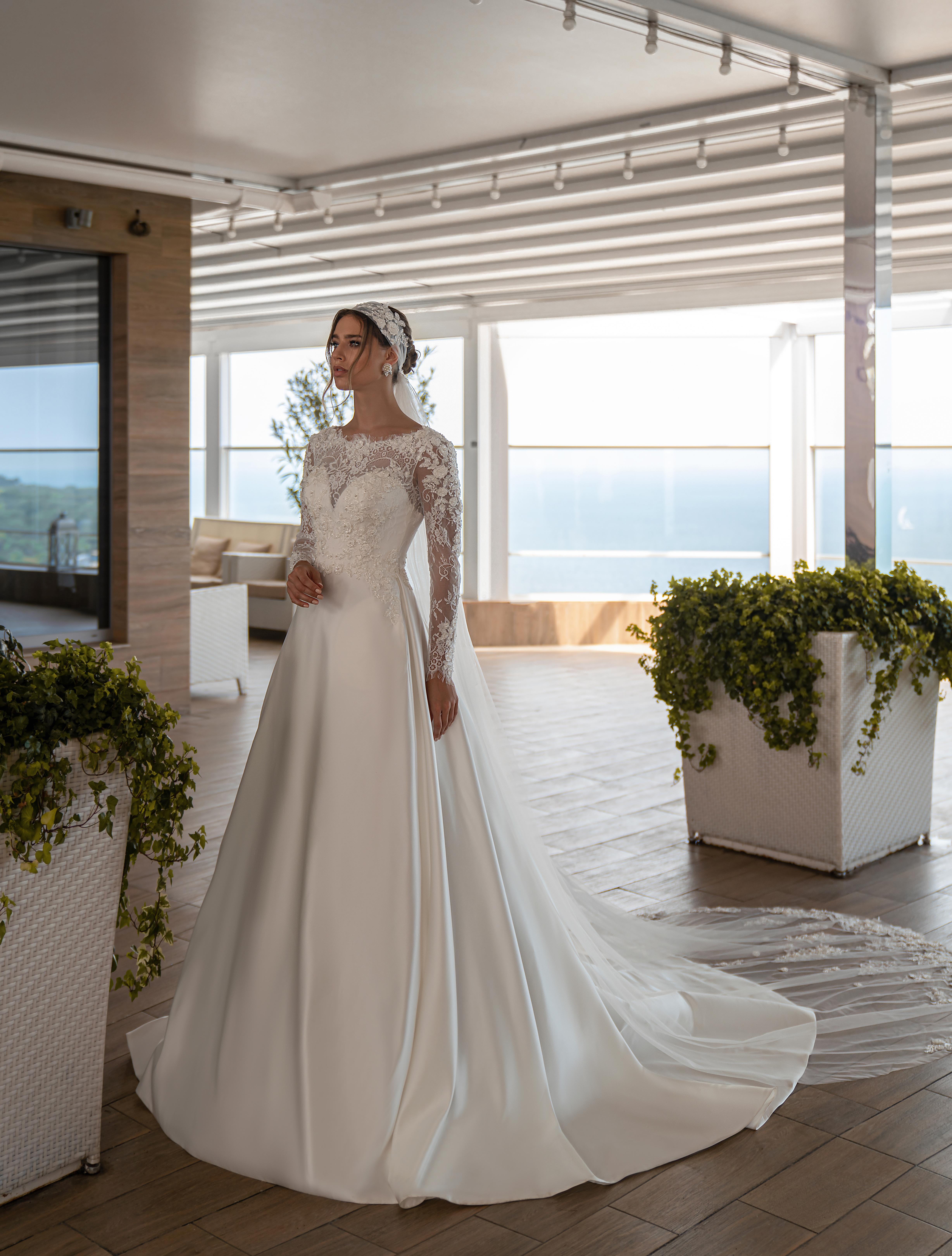 Весільна сукня з довгими рукавами оптом від Supernova-1