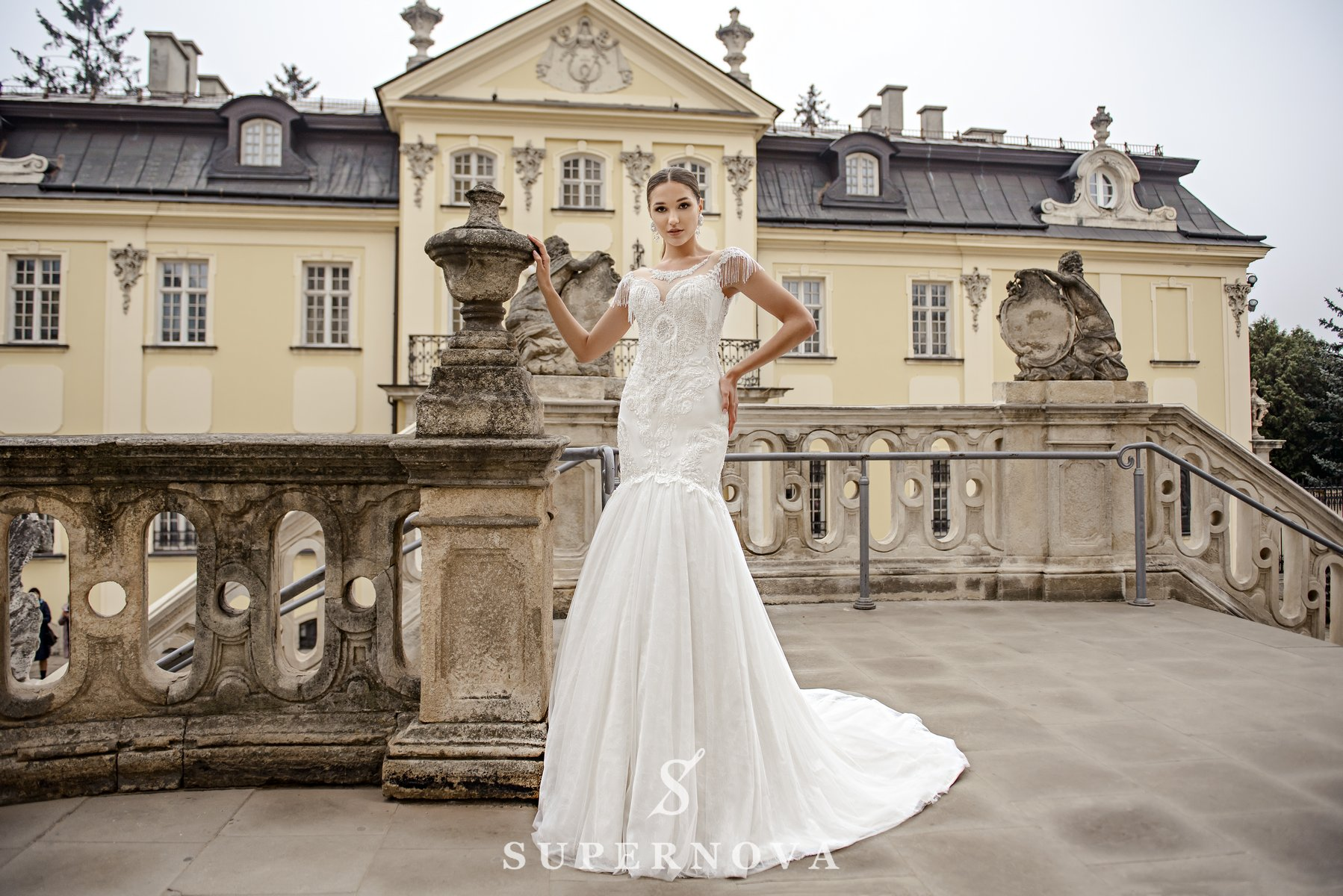 Ivory fishtail wedding dress embroidered with pearls on wholesale from SuperNova-1
